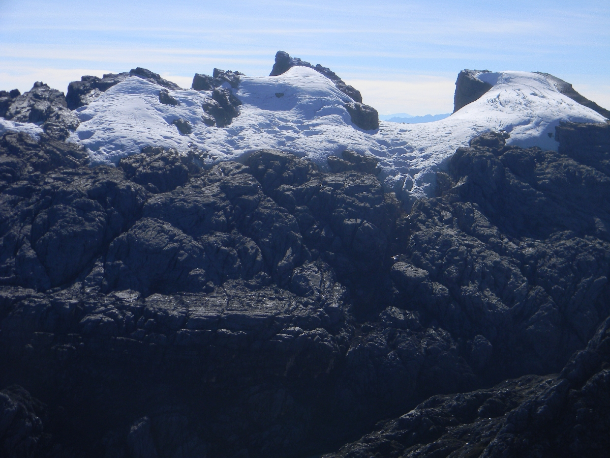 Sumantri and Puncak Jaya from Carstensz summit ridge (Robert Cassady, 2010)